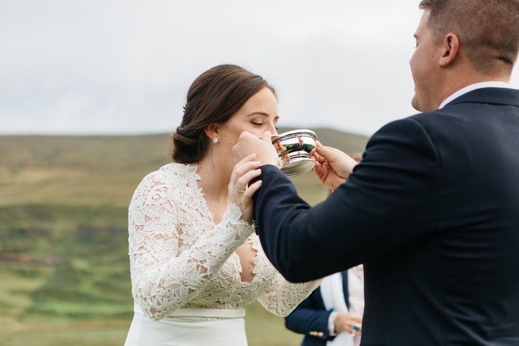 groom gives bride celebratory drink