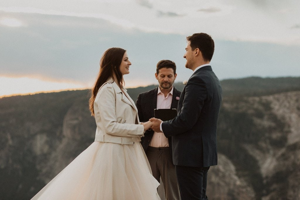 officiant marries couple for sunset elopement.