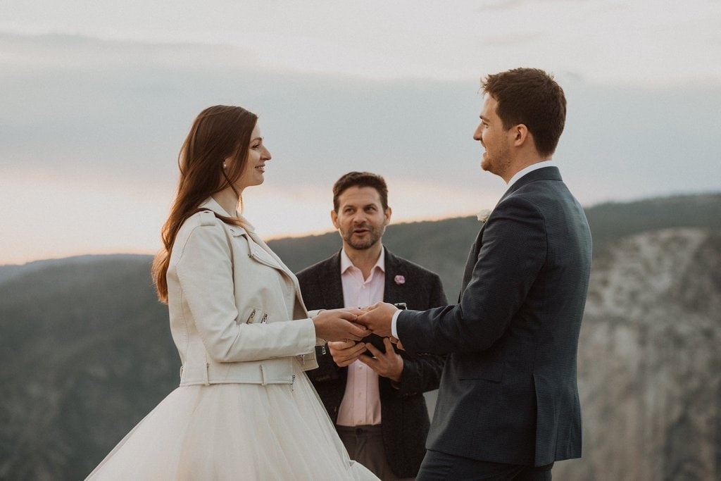 couple says I do on top of mountain.