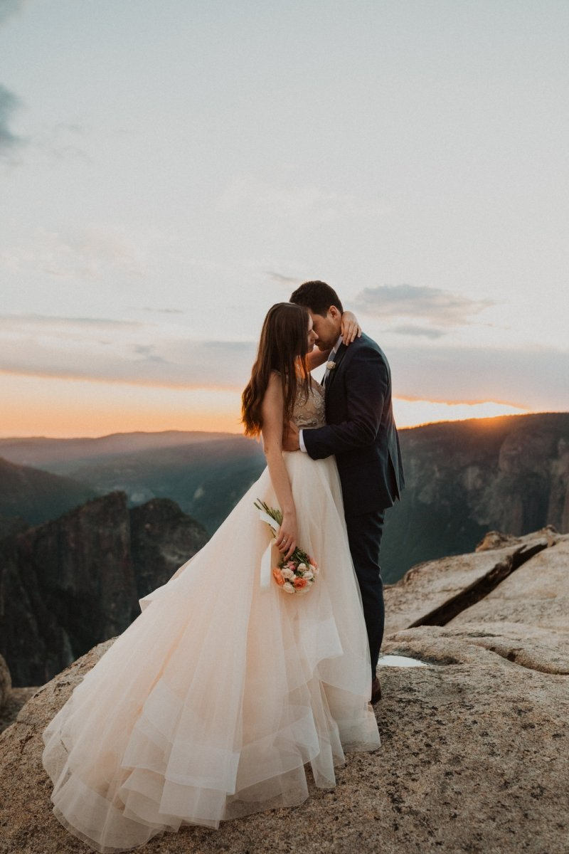 Intimate moment for bride and groom at Taft Point.