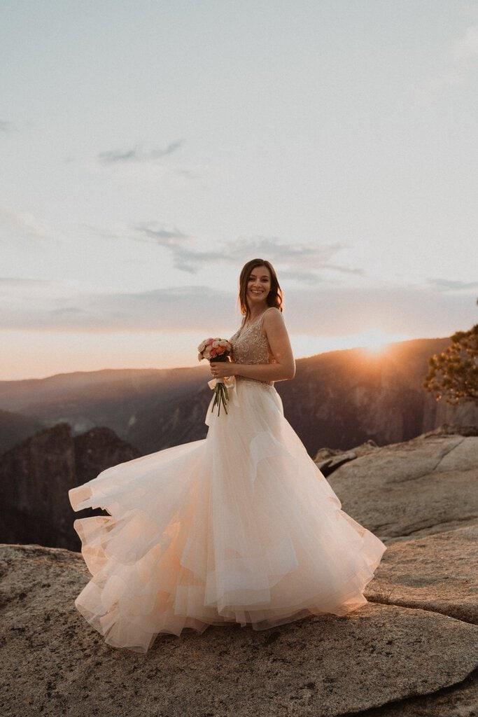 bride twirls her wedding dress.