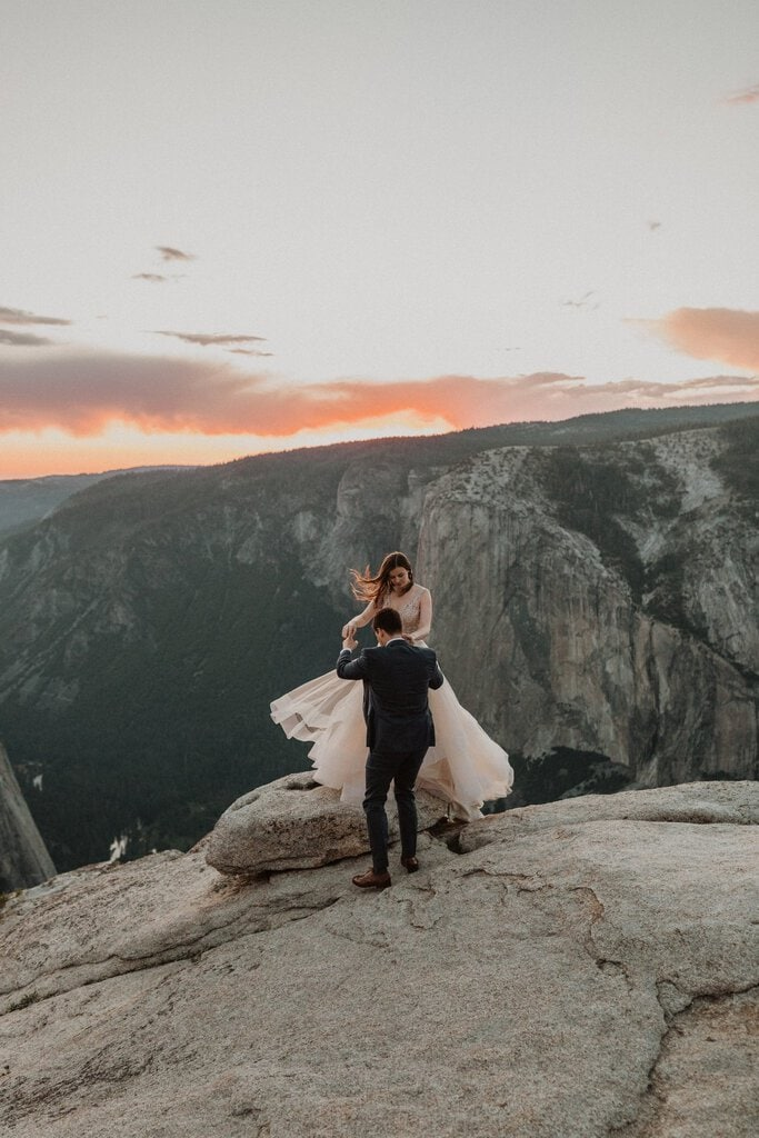 bride and groom celebrate on California's mountain top.