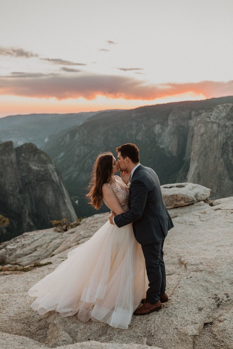 couple kiss at intimate elopement.