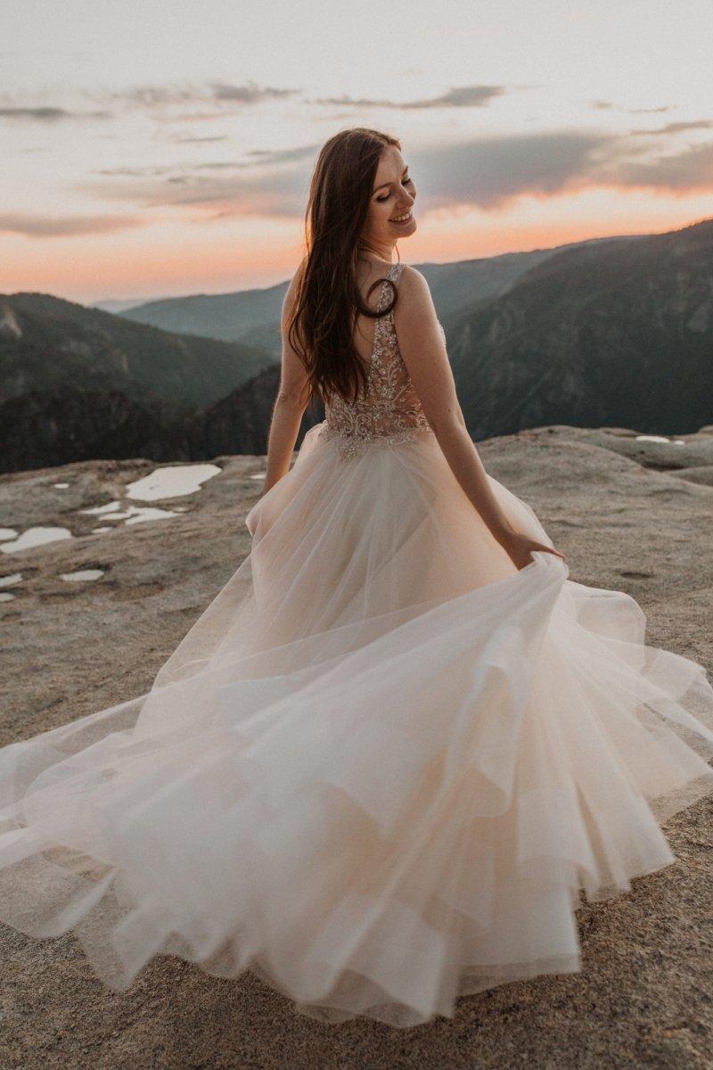 bride twirls her dress in excitement.