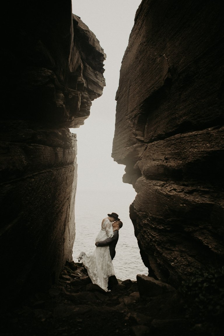 Bride and groom share a kiss at Cliffs of Moher.