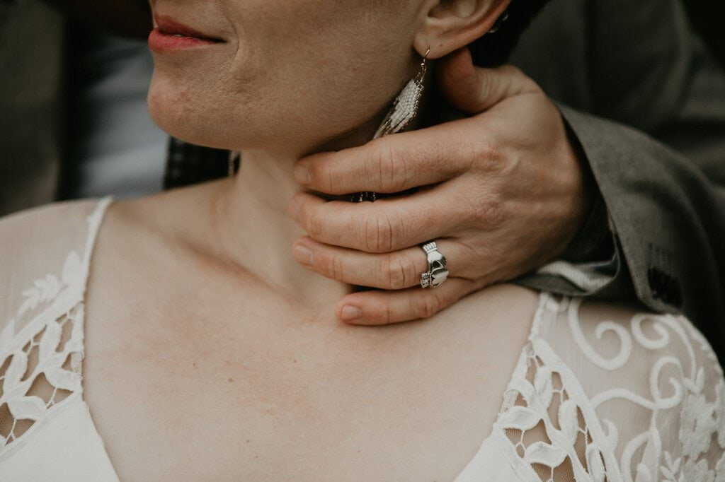 Detail photography of bride and groom's jewelry.