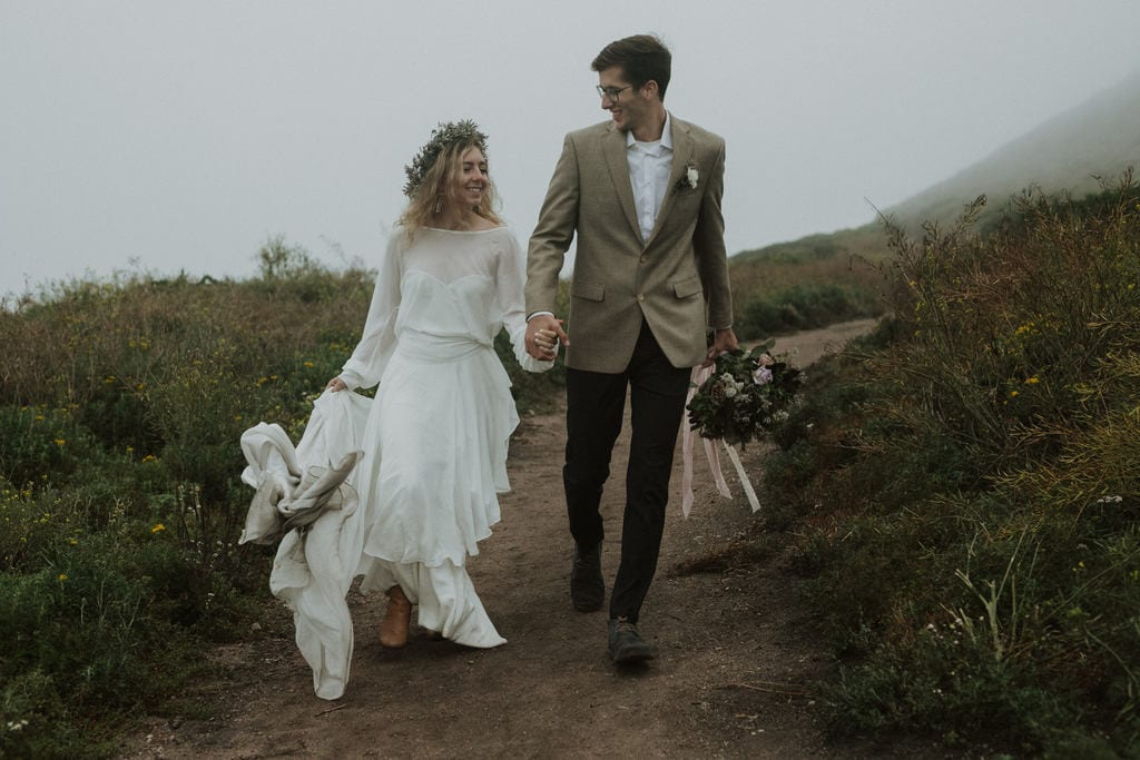Bride and groom end the day hand in hand at Garrapata State Park.
