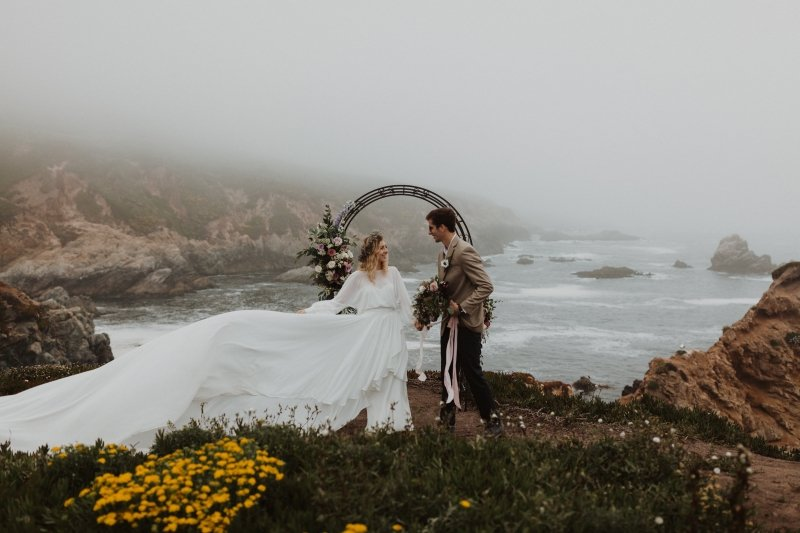 Harriett Falvey boho bridal dress flowing in the wind during ceremony.