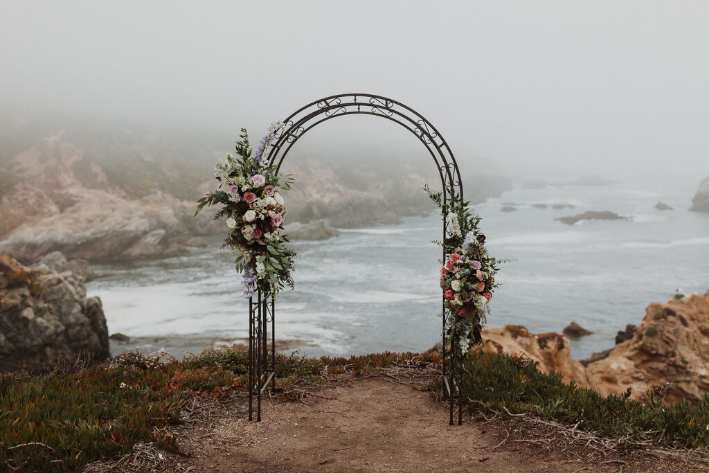 elopement arch for a seaside wedding ceremony.