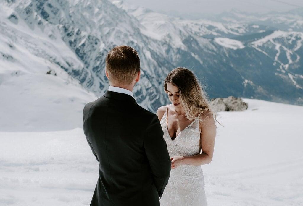 Winter elopement vow exchange.
