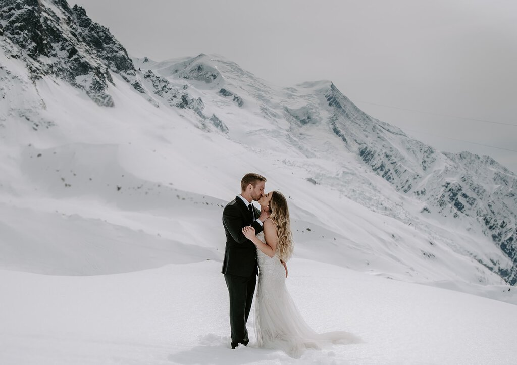 Bride and groom in the snowy mountains of France.