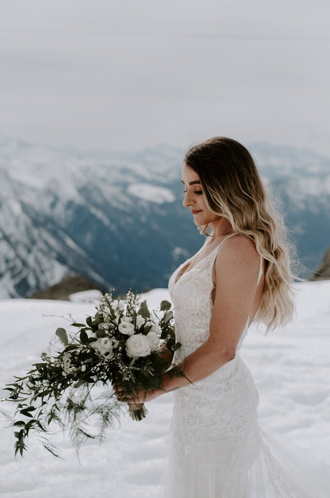 Bride with her winter wedding bouquet.