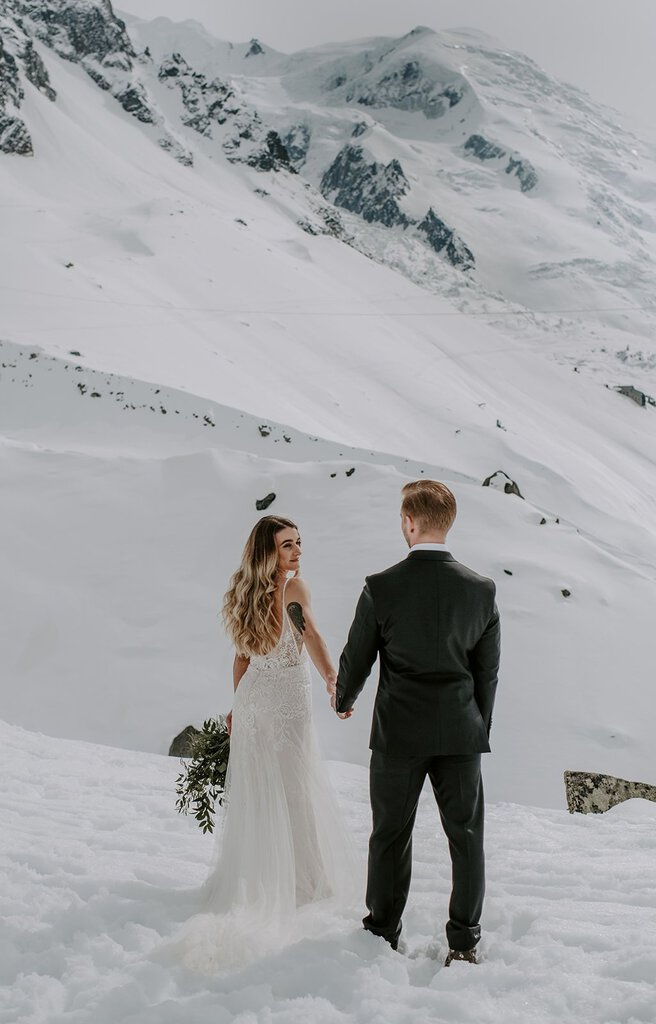Bridal portrait in the snowy mountains of France.