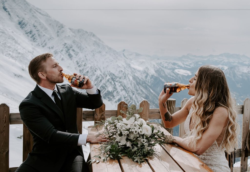 Bride and groom make a toast in France.