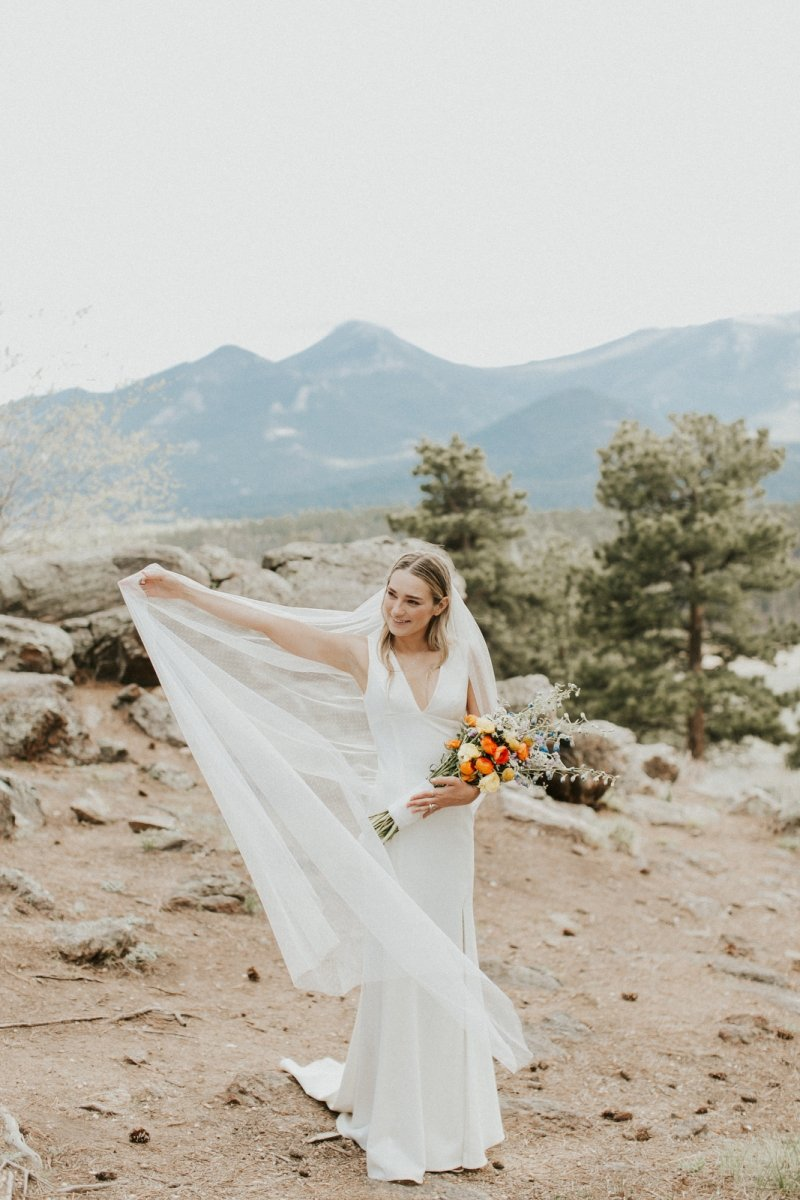 Bridal portrait at sleepy hollow park, rocky mountain national park in Colorado