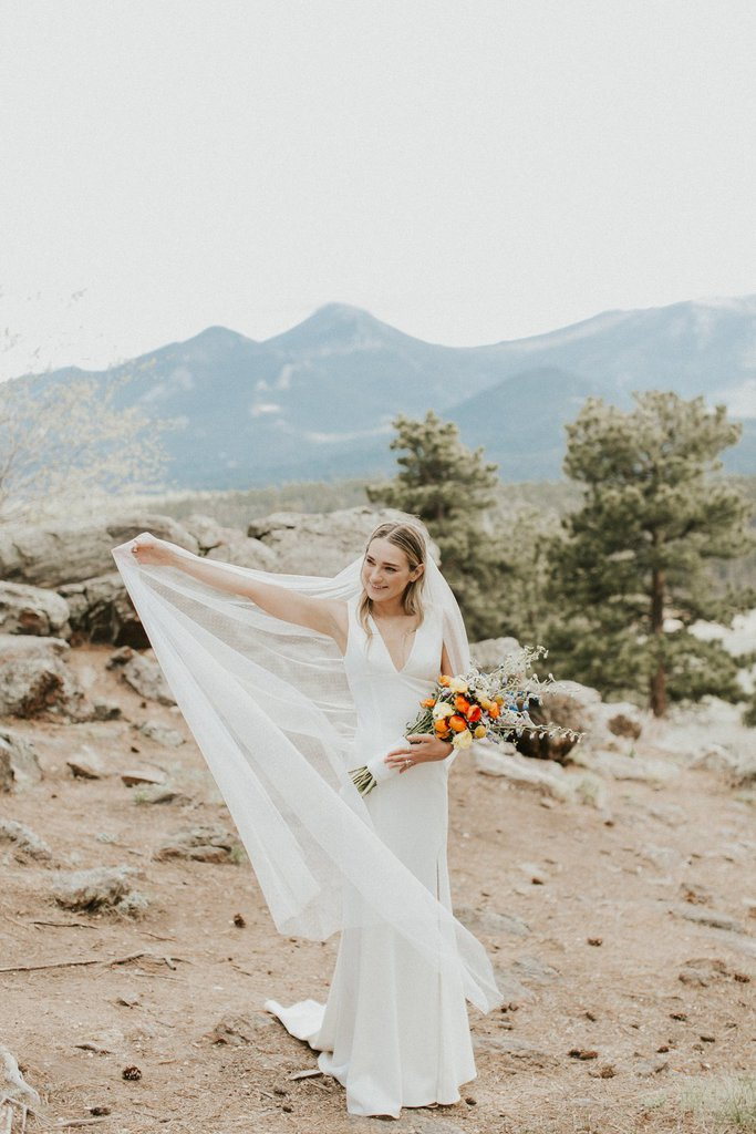 Bridal portrait at sleepy hollow park, rocky mountain national park in Colorado