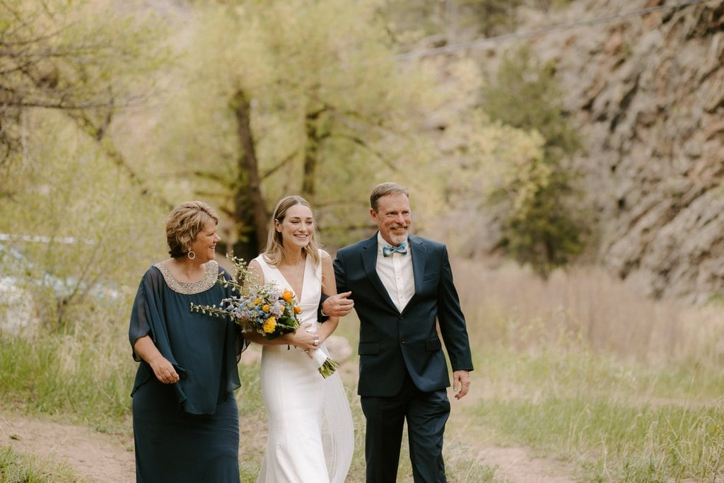 Mother and Father of Bride walking down the aisle for intimate wedding in Colorado