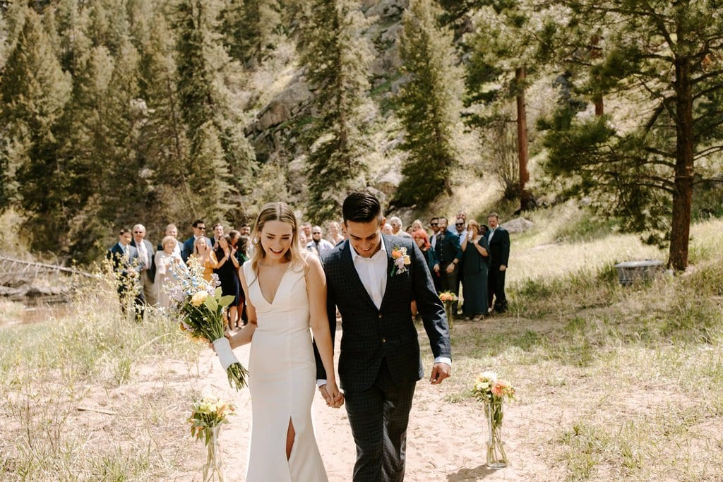 Adventurous wedding party celebrate bride and groom in Colorado's national park