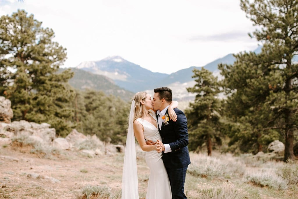 Bride and groom share a kiss at rocky mountain national park