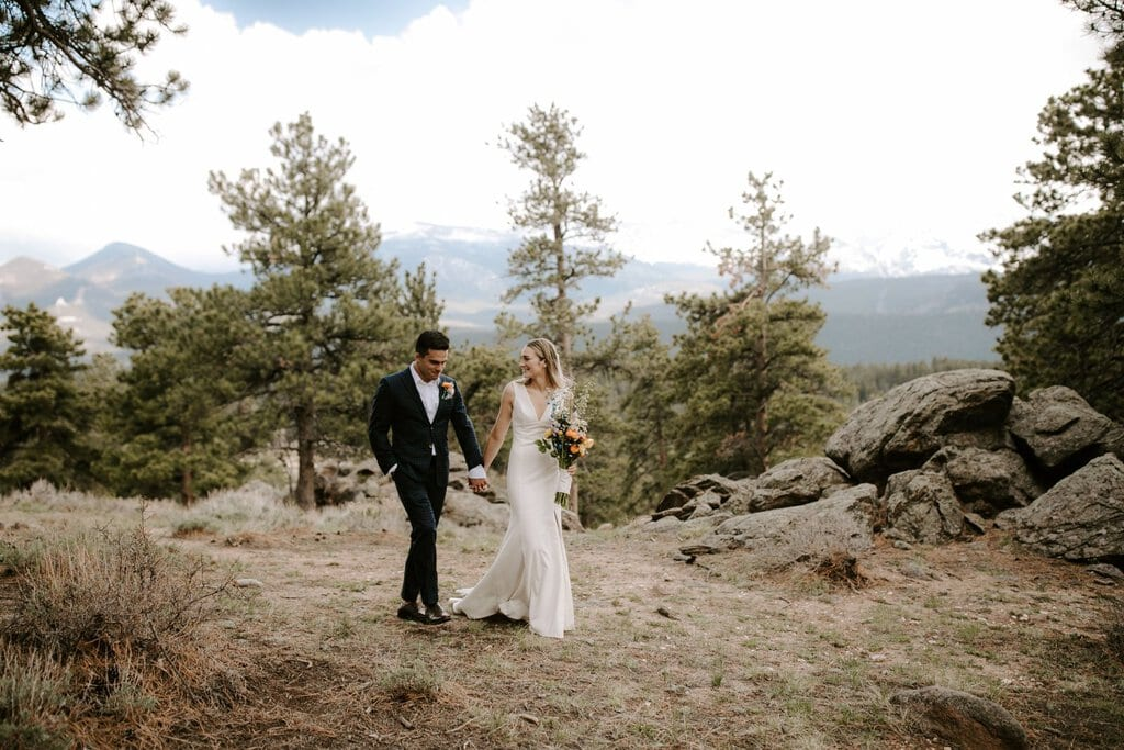 Newlyweds had an adventurous walk through rocky mountain.