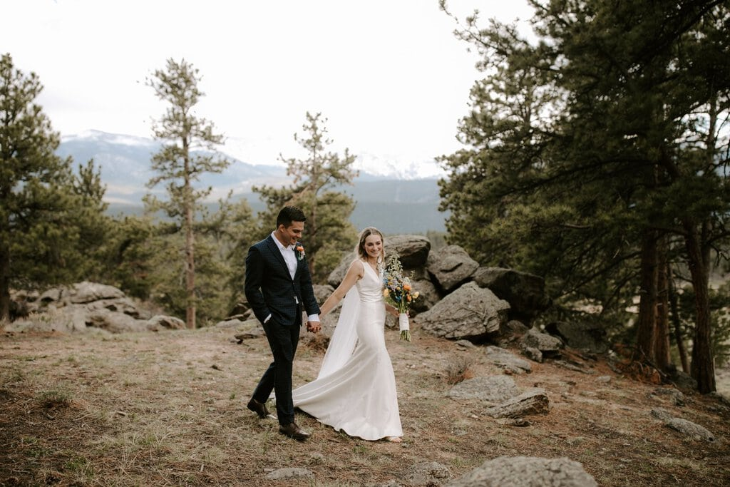 bride and groom walking in Colorado.