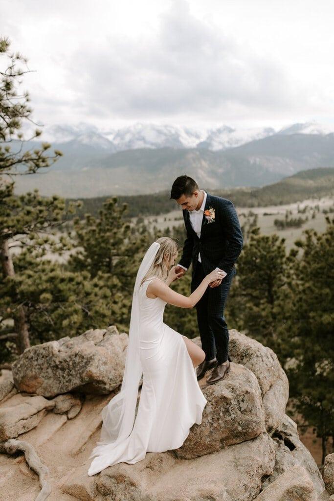 Bride and groom climbing at sleepy hollow park