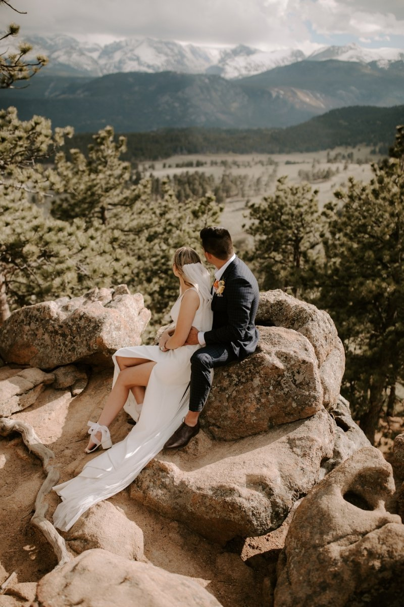 Bride and groom looking off into the distance in Colorado.