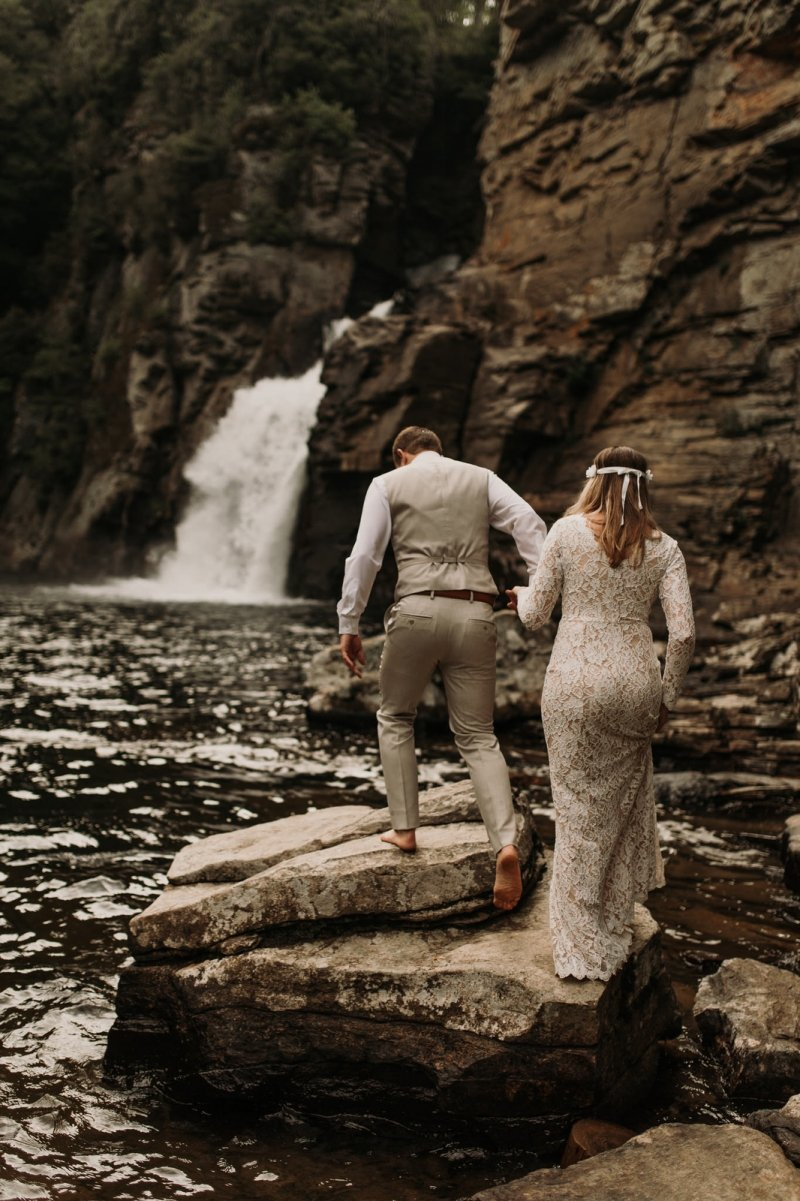 bride and groom hike in linville gorge wilderness.