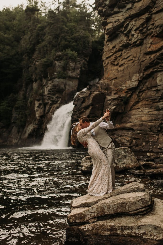 bride and groom have fun in Linville Gorge Wilderness
