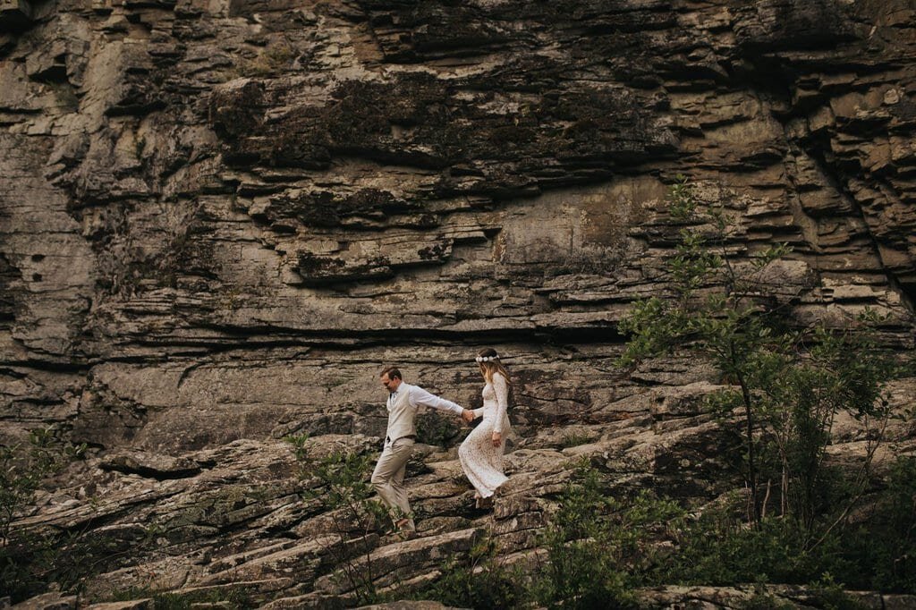 bride and groom hiking in North Carolina.