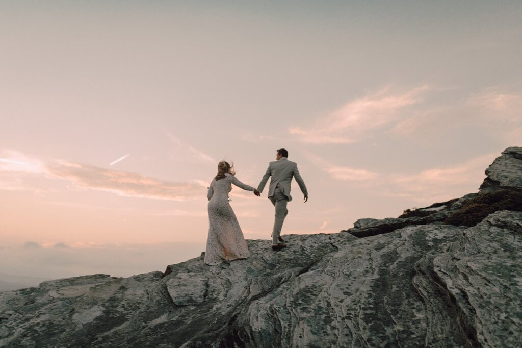 Newlyweds hike up north Carolina mountain.