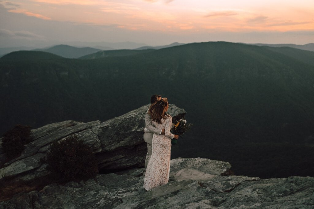 newlyweds celebrate marriage on mountain.
