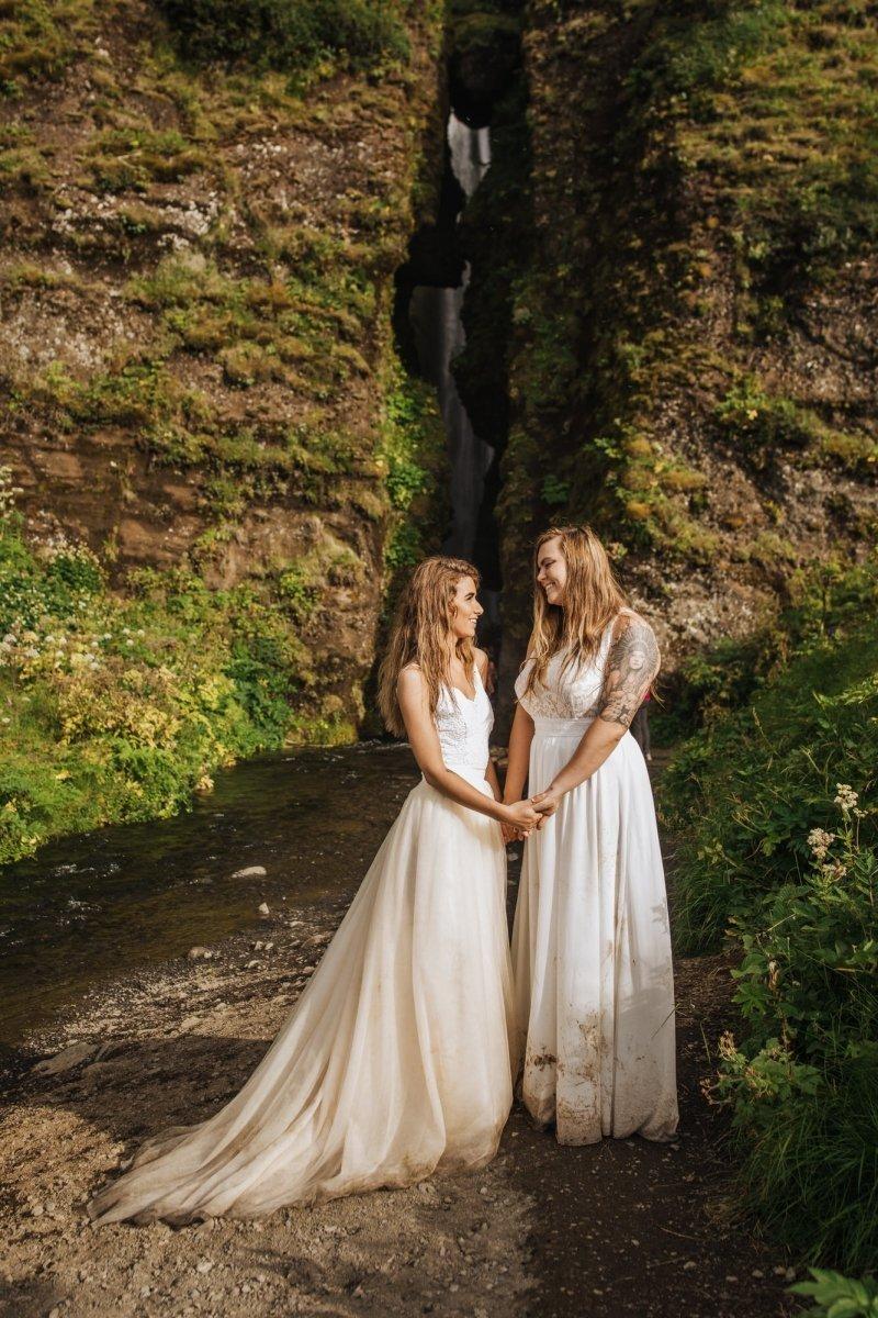 Brides holding hands.