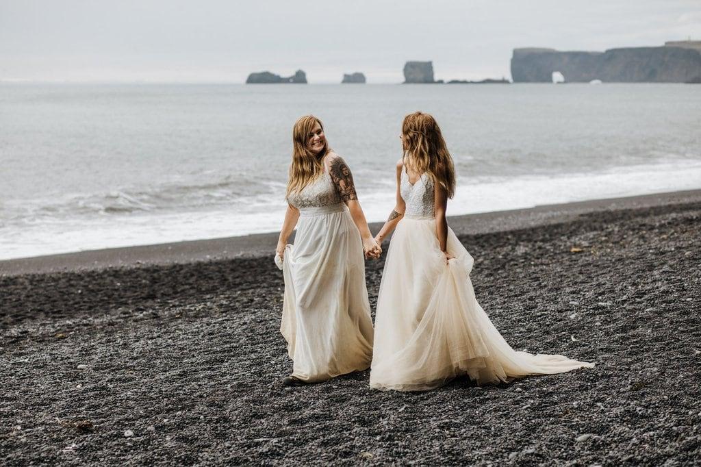 Couple walking down the ocean.