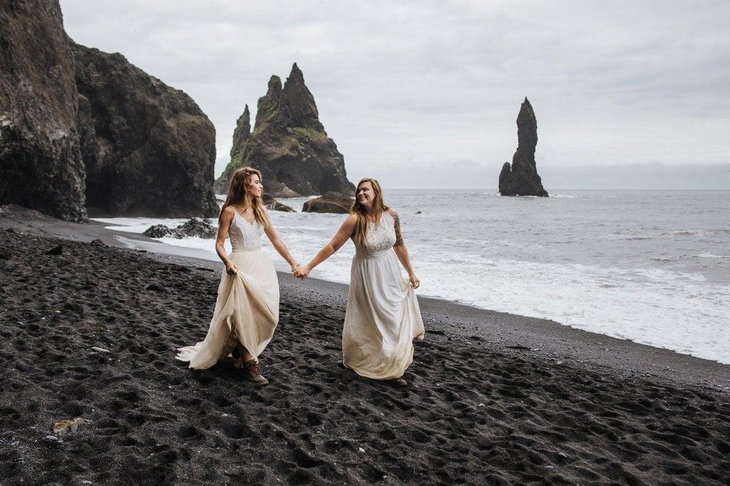 Brides walking down the beach.