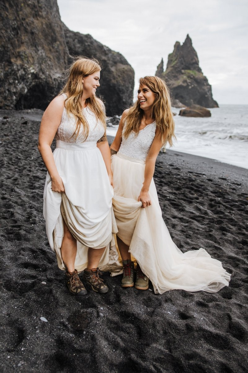 Brides in their dresses and hiking boots.