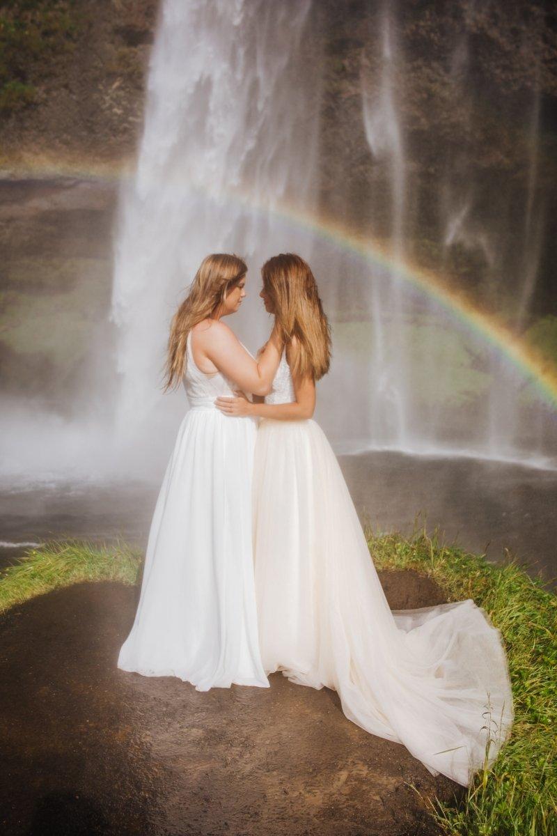 Brides looking at waterfall.