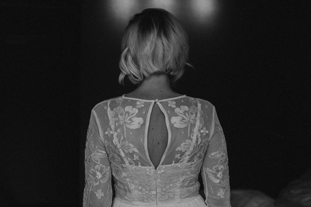 bridal portrait of ASOS wedding dress back.