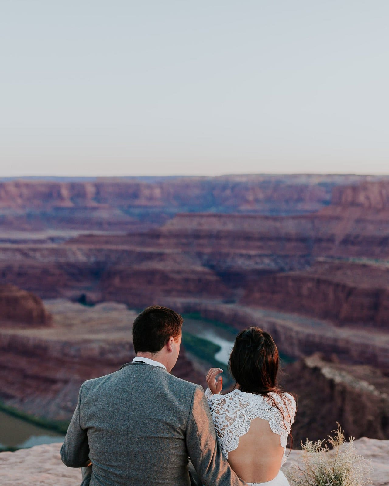 Couple stare at the mountains of Moab Utah.