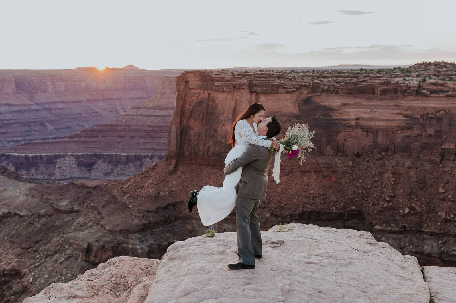 Couple celebrating marriage at Moab, Utah.