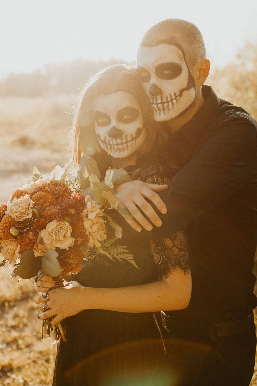 couple embrace for Halloween inspired shoot.