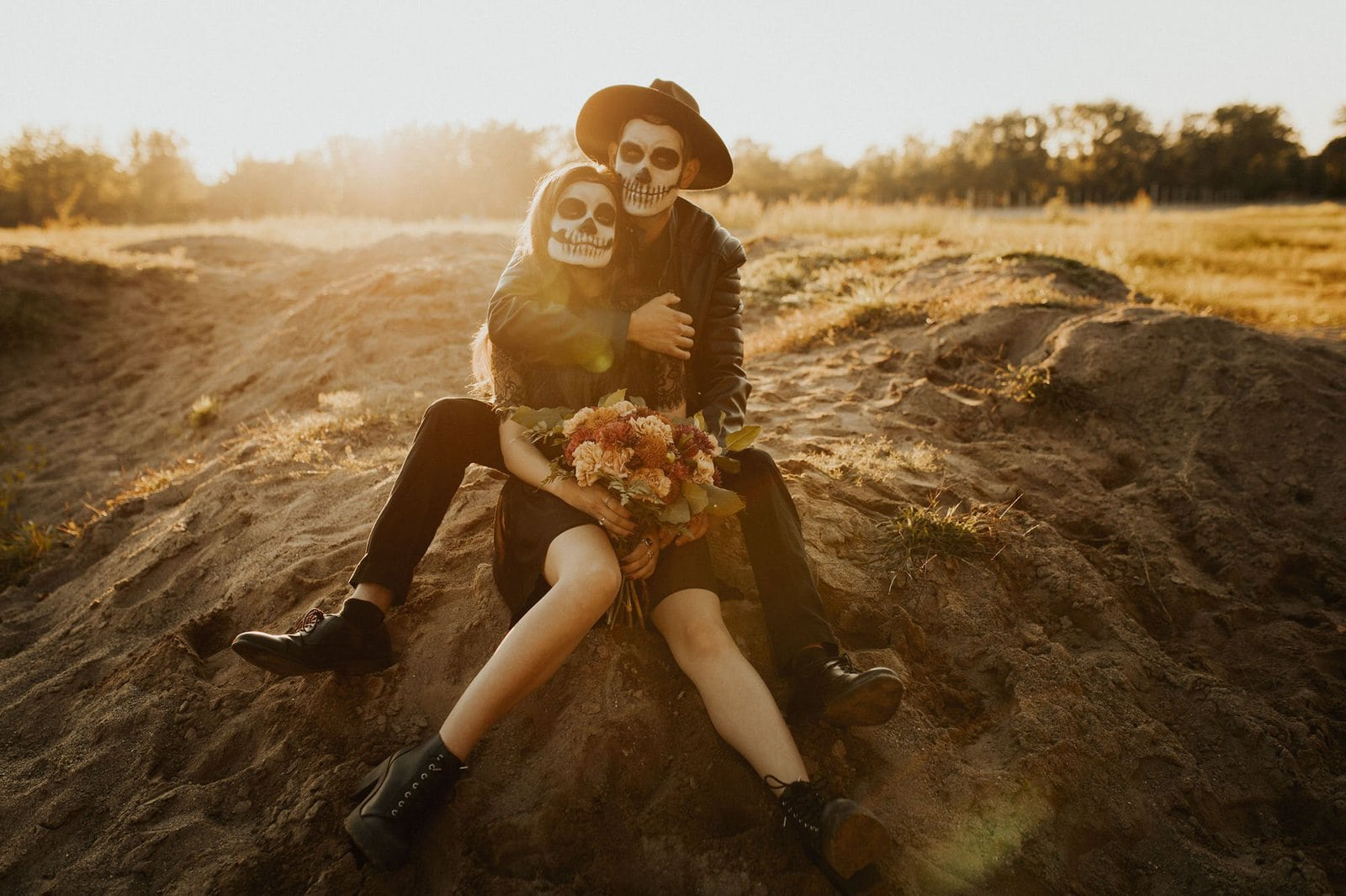 couple embracing in fall inspired session.