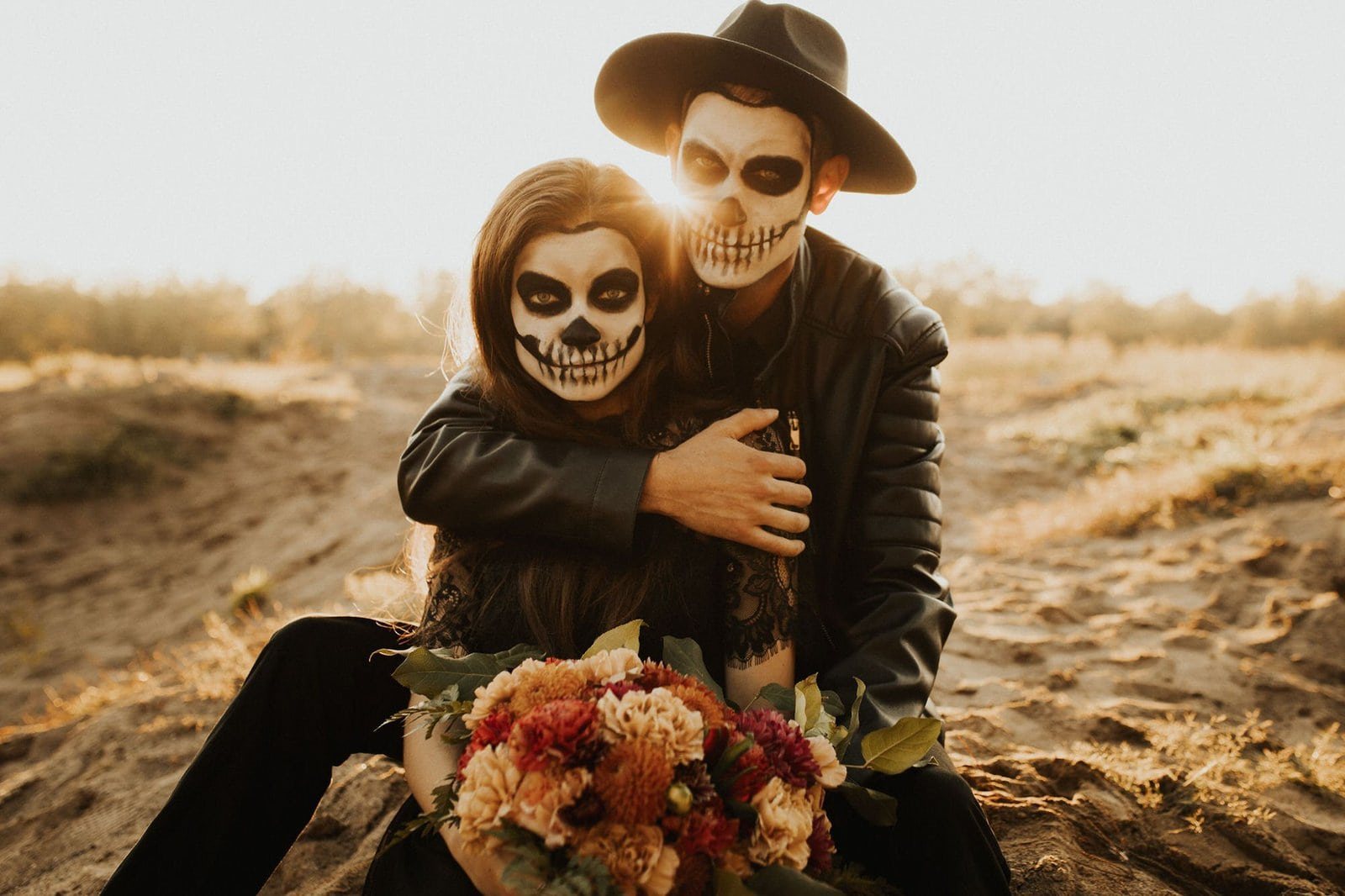 couple in skeleton faces.