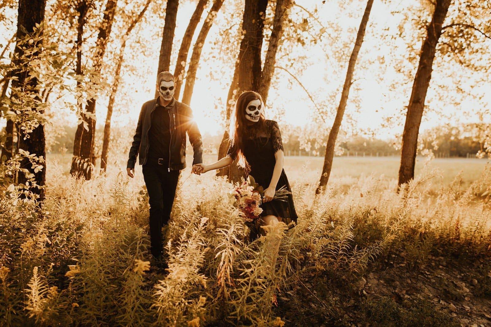 couple walk in forest.