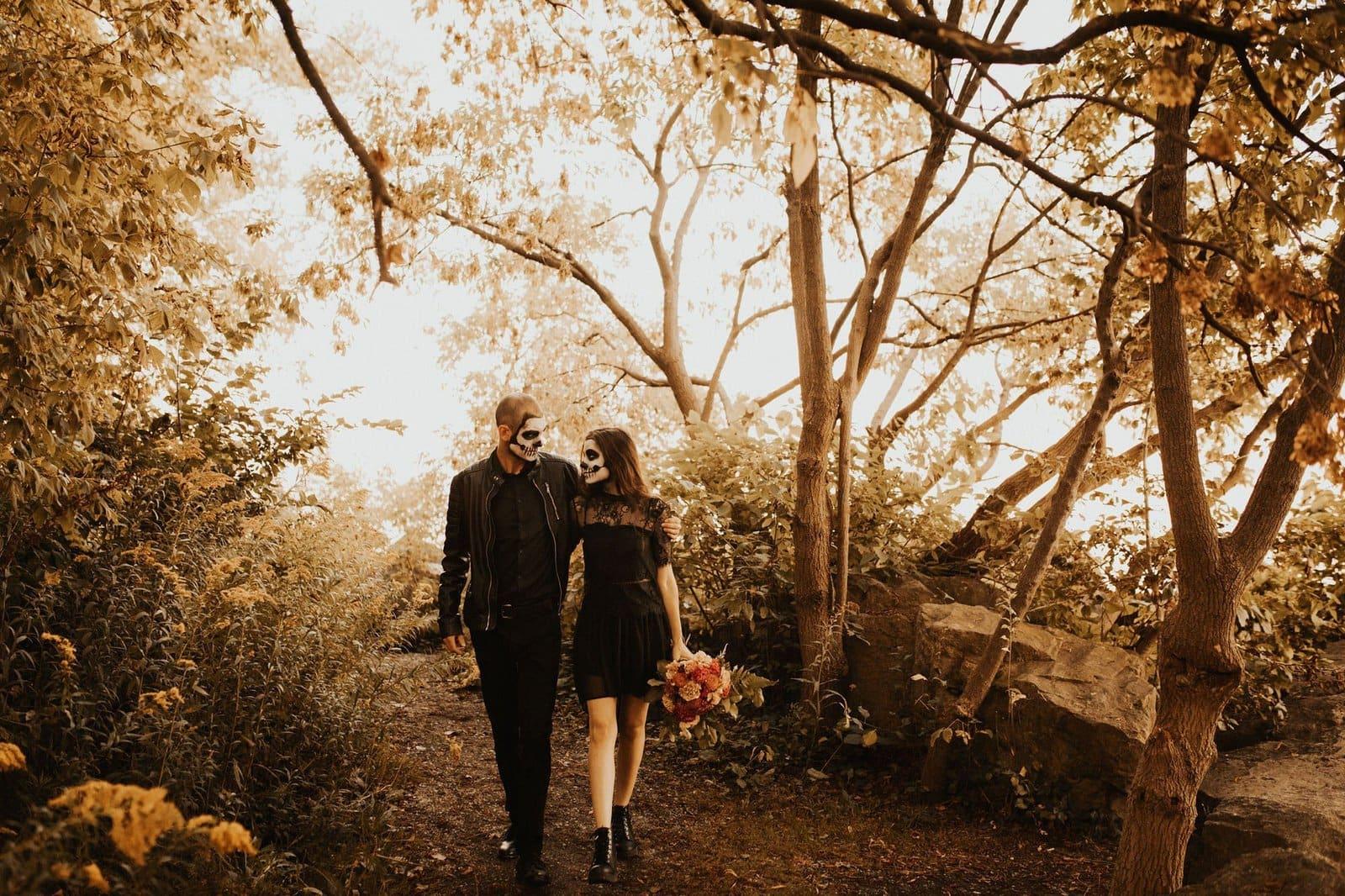 halloween couple walking hand in hand.