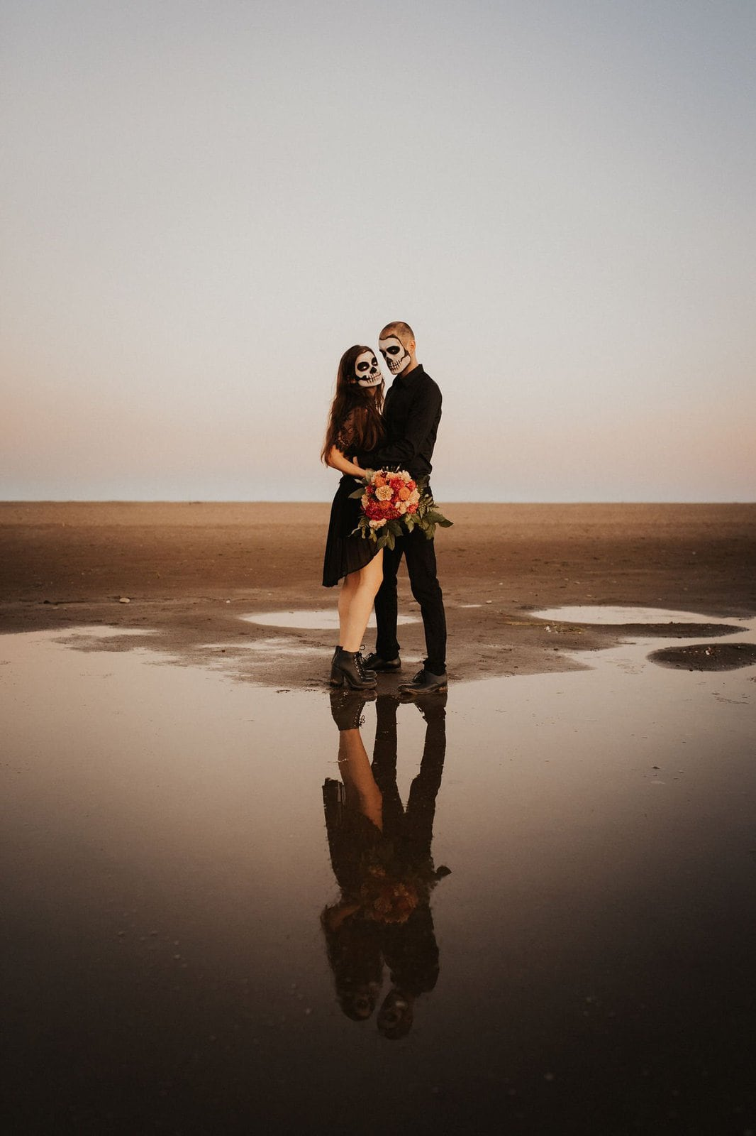 couple at the beach for fall shoot.