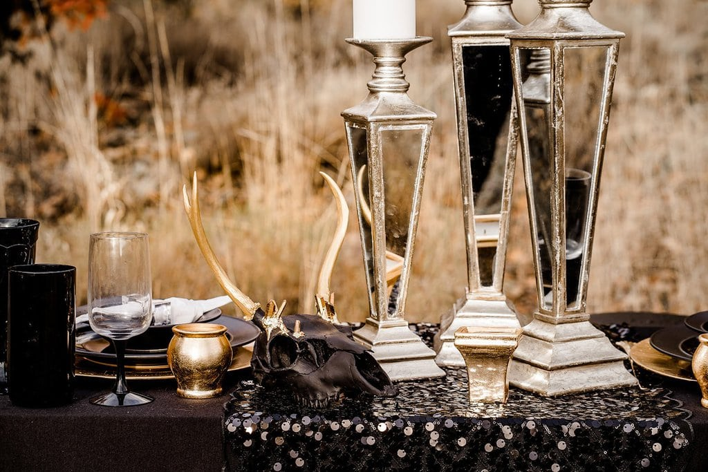 Gold and black decor for halloween wedding.