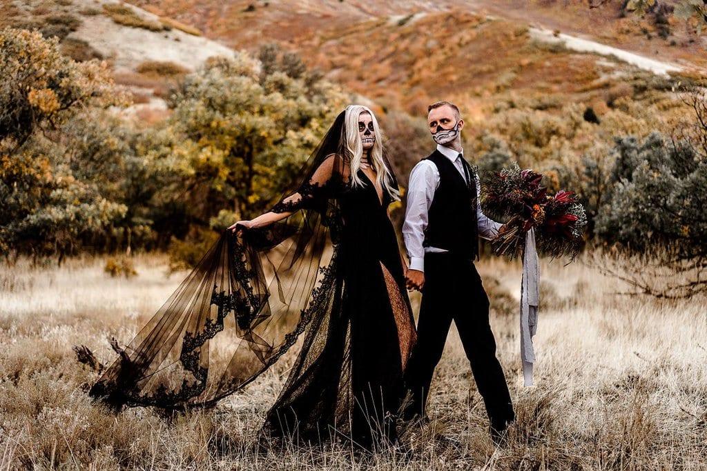 Bride and groom intimate wedding for Halloween.