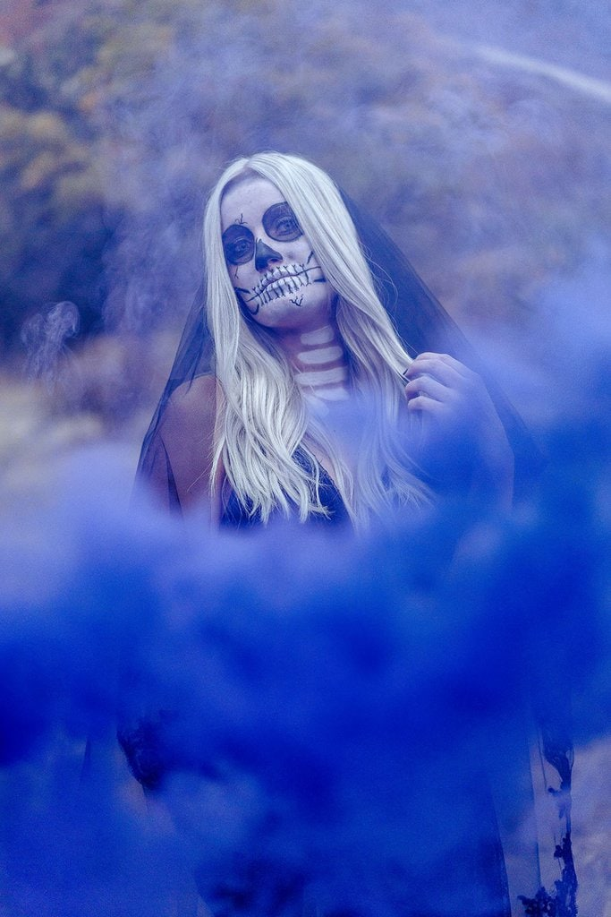 Blue smoke bomb bride with skull paint.