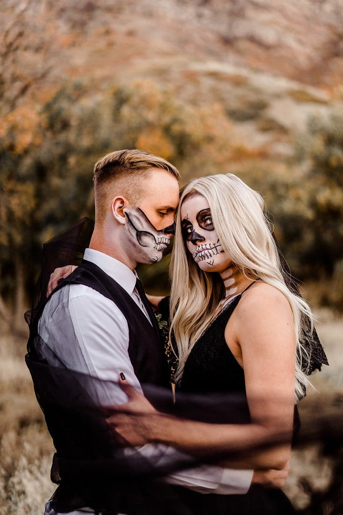 Bride and groom with skull paint.
